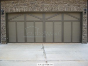 Custom carriage style garage door. Painted to match exterior of the home.