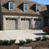 Custom made, carriage style garage doors with glass installed in Cumming, GA