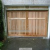 A custom made header and carriage style garage door installed in metro Atlanta