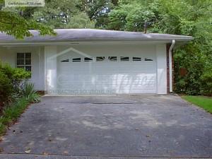 Enclosed Carport with Steel Garage Door, Glazed.