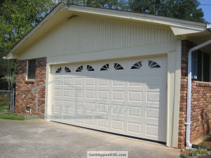 Carport Enclosure with Steel Garage Door and Wagon Wheel Inserts in Stone Mountain, GA