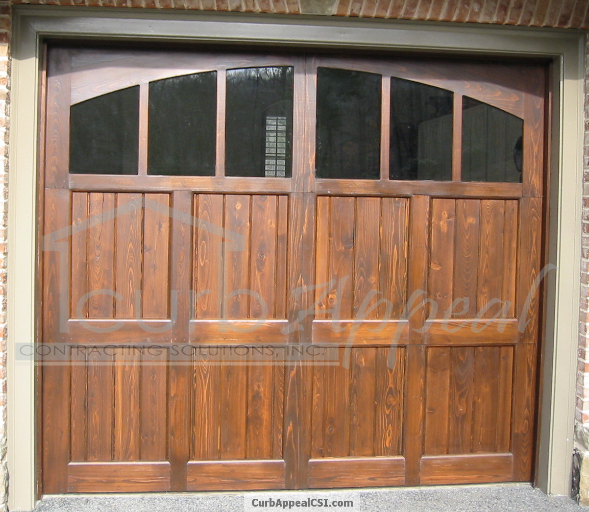 Stained cedar carriage style garage door glass and arched for Best wood for garage doors