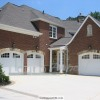White Classica Garage Doors With Arched Glazed Tops in Duluth, GA