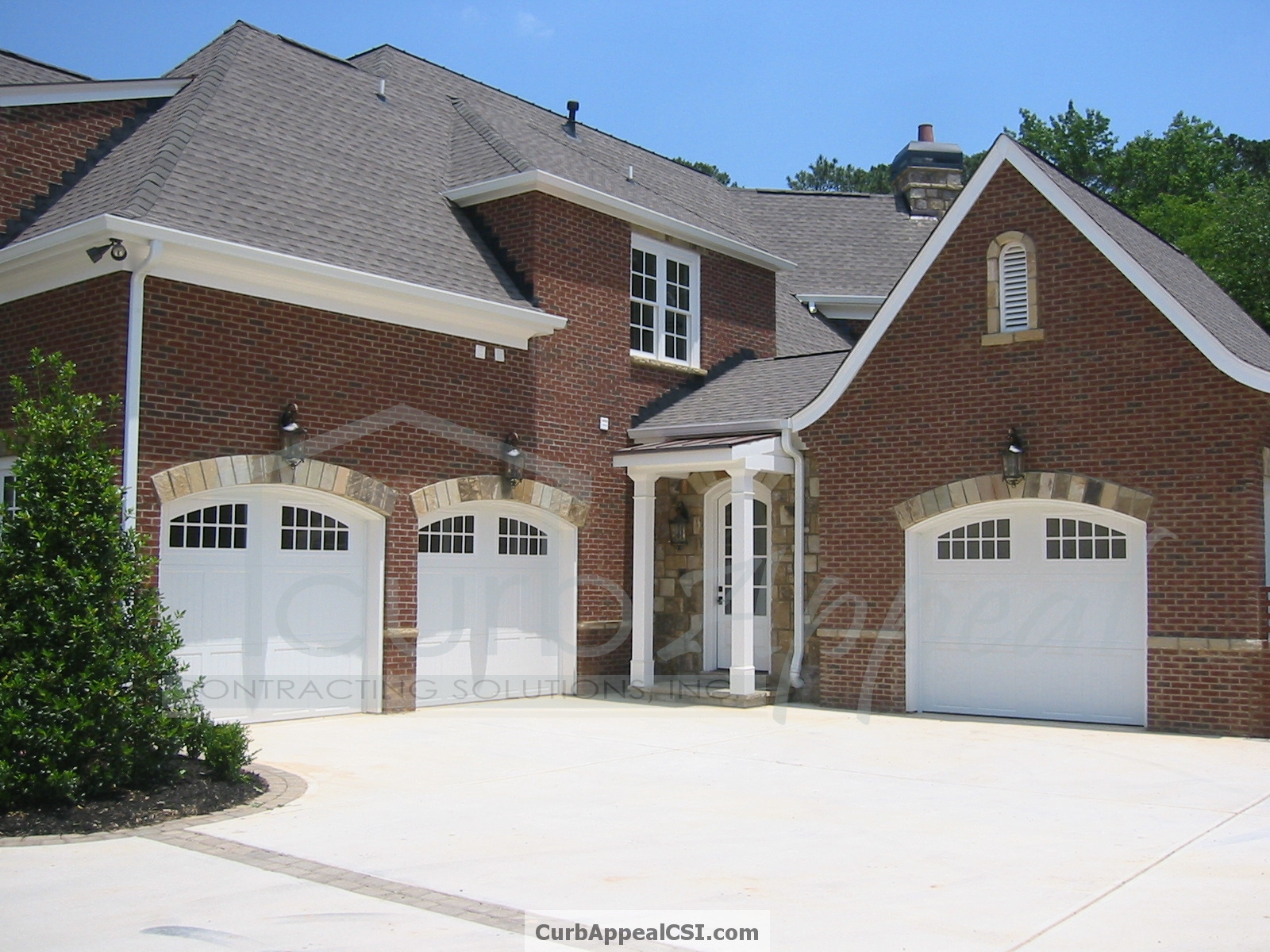 White Classica Garage Doors With Arched Glazed Tops Curb