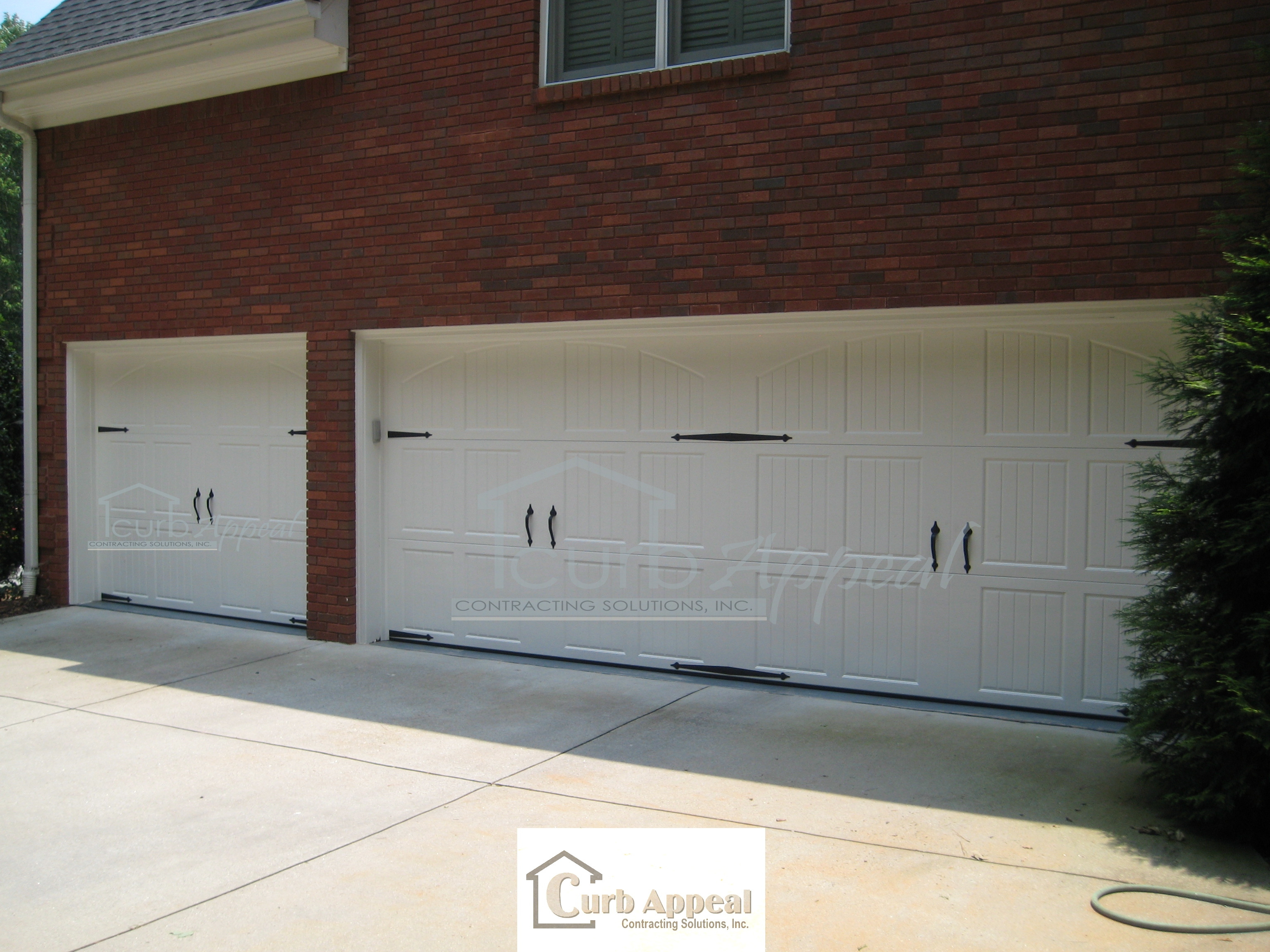 Classica garage door in Tuscany with closed arched tops. Marietta, GA
