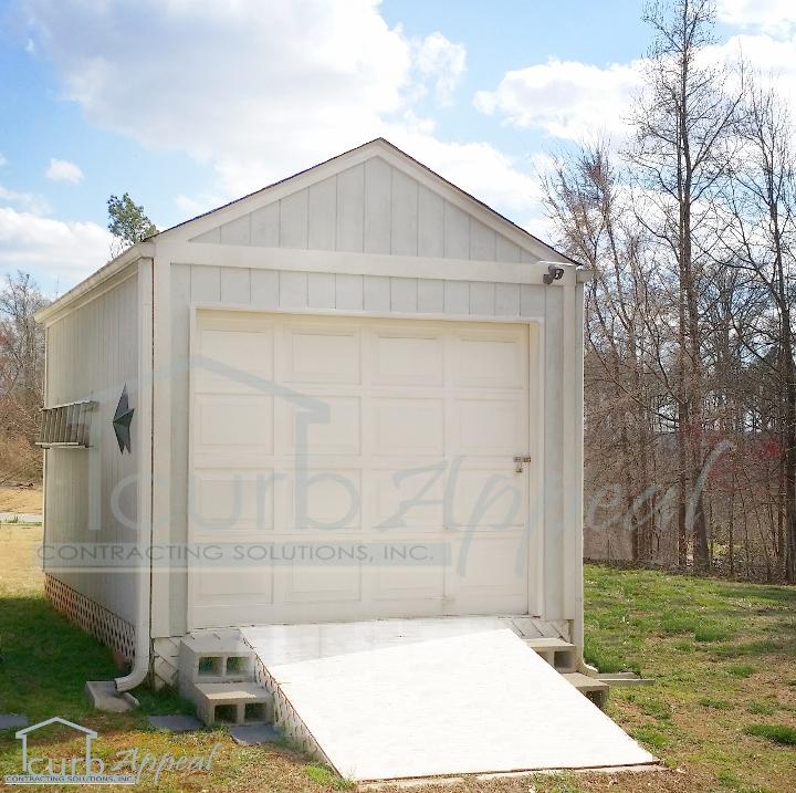 Custom garage building metal wood storage buildings for Garage builders atlanta