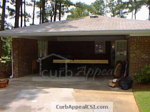 carport with 3 brick walls before framing in for garage door installation