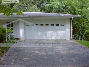 Enclosed Carport with Steel Garage Door, Glazed.