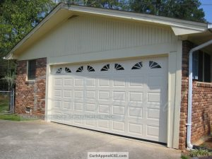 Carport Enclosure with Steel Garage Door and Wagon Wheel Inserts