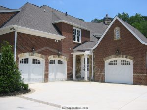 White Classica Garage Doors With Arched Glazed Tops