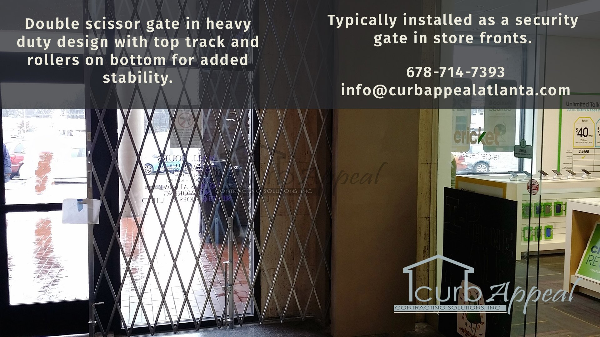 a storefront gate protecting glass entry doors in a retail space